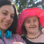 Down Syndrome smiling with carer