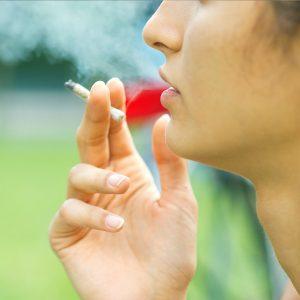 Woman smoking drugs