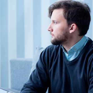 Man looking away from therapist