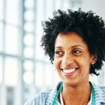 Nurse smiling away from camera